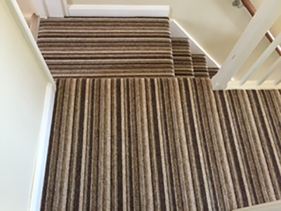 Striped Carpet On Stairs And Landing